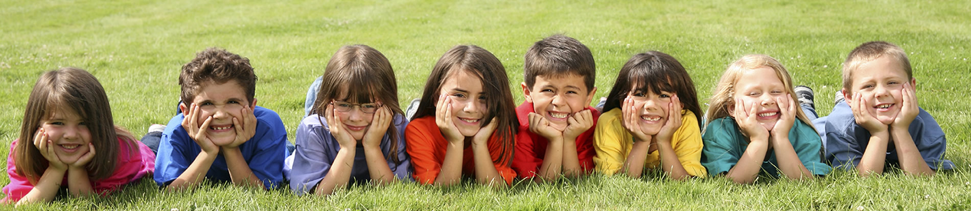 group of kids in the grass