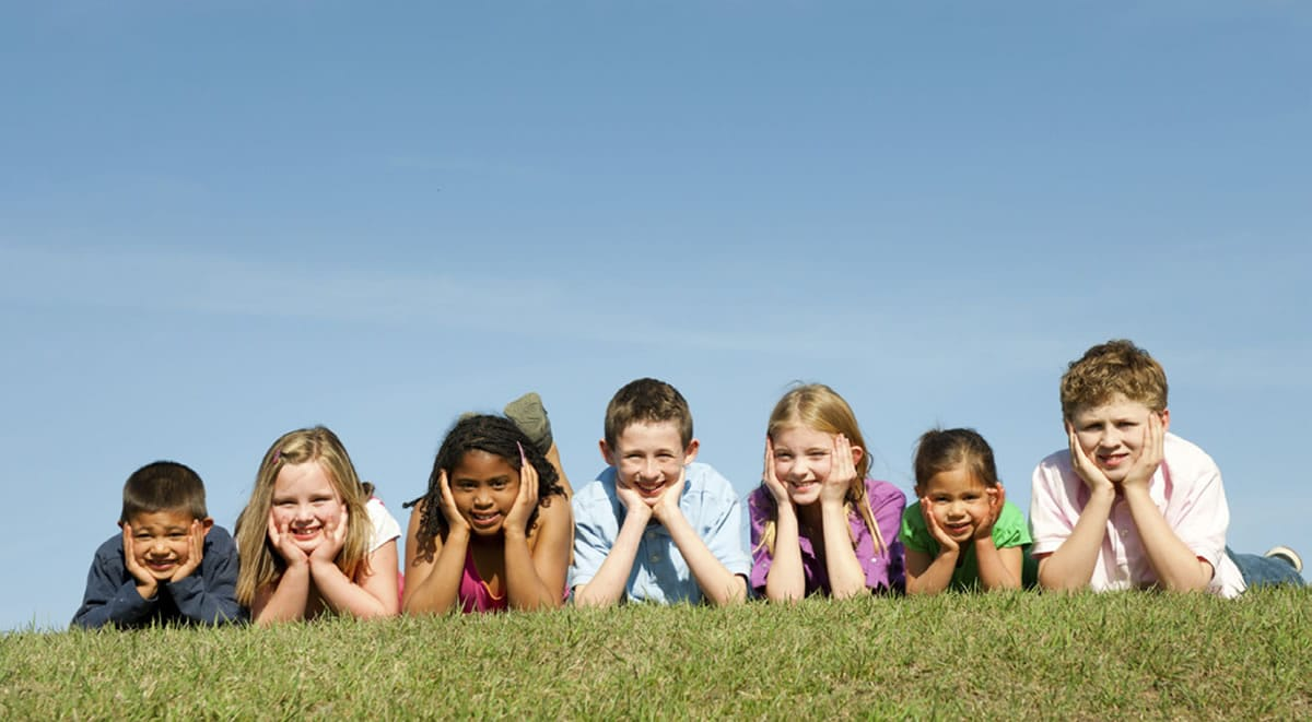 group of children in the grass