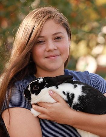 Alexis holding a bunny