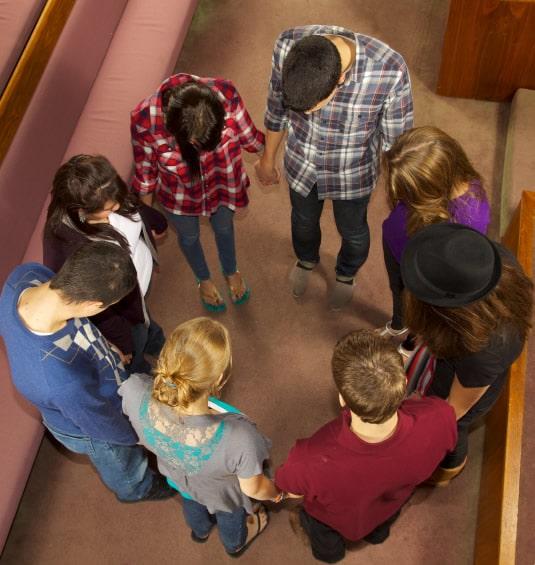 People Praying In A Circle