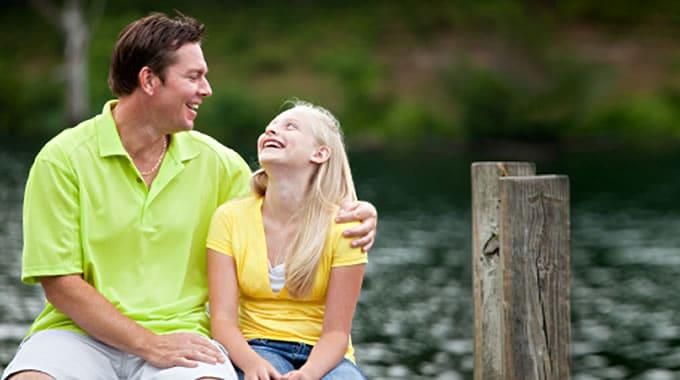 man and girl at fishing dock
