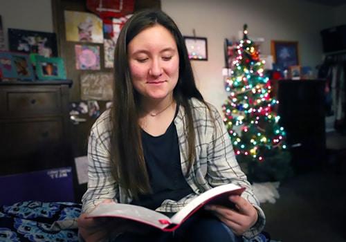 teenage girl reading her bible at Christmas time