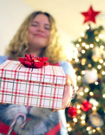 teenage girl holding a Christmas gift