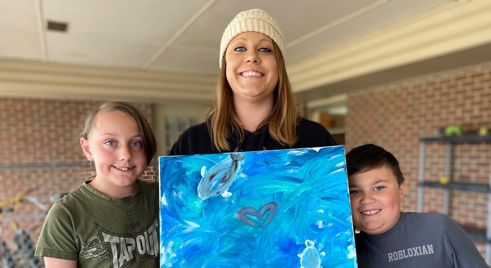 Children's Hope mother and her children create artwork together in their down time.