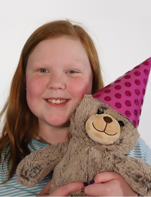 girl holding circus bear
