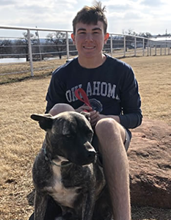 Teenage boy with a dog