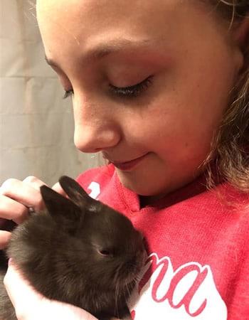 Girl cuddling a bunny